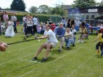 The mens entry in the tug-of-war.  Believe it or not that's an elephant on the end of the rope!!!