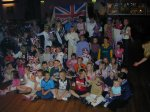 Everyone gathers round for the photo shoot.